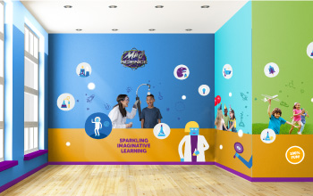 Mad science party room with illustrations on the wall and a picture of a mad scientist and child performing an experiment
