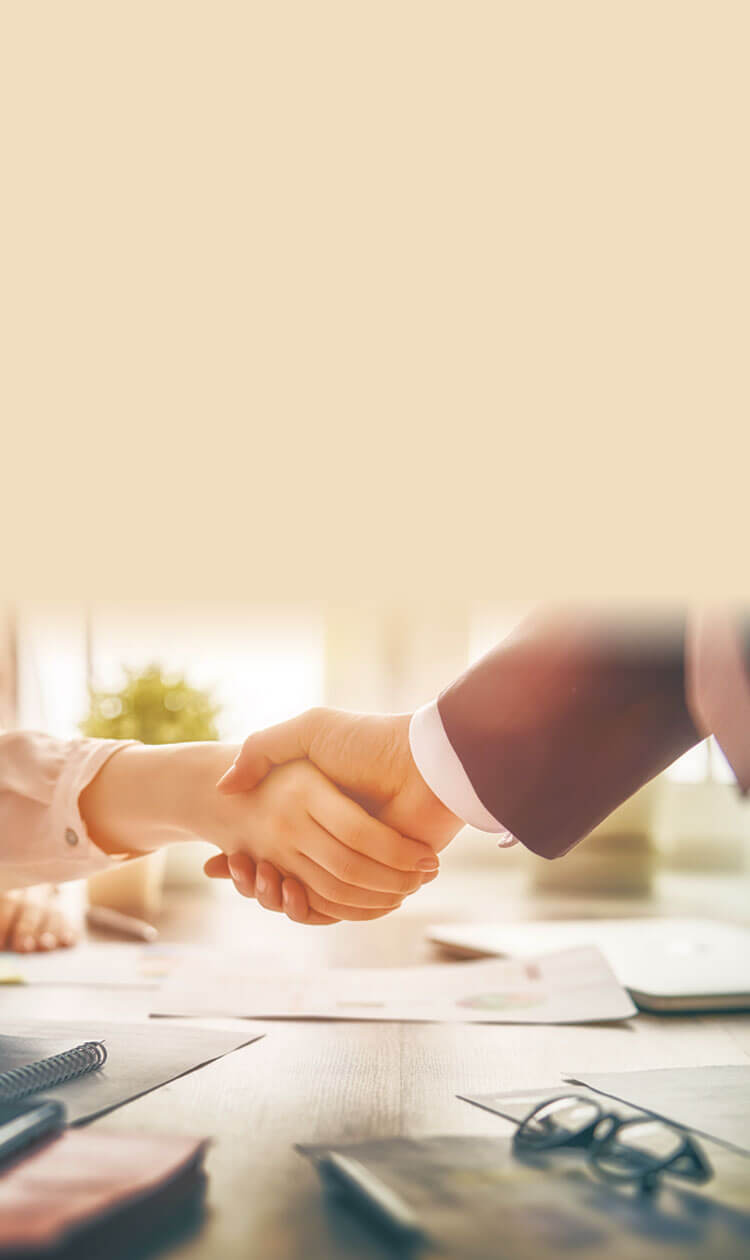 arms of a man and a women shaking hands in a business environment