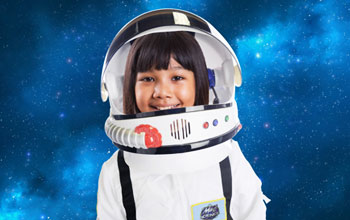 Girl wearing a spacesuit with a background of outer space