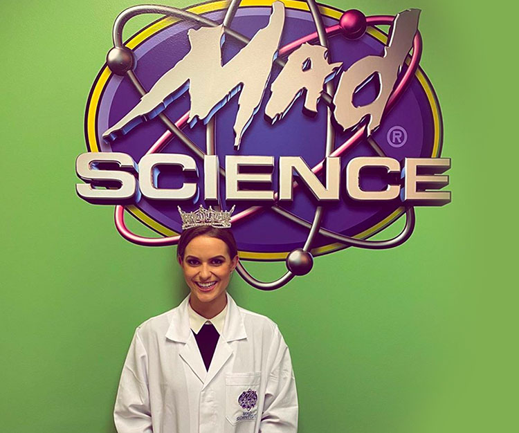 miss America standing with mad science logo