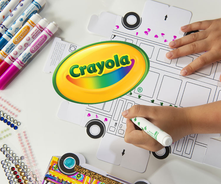 A kids hand coloring a bus with a crayola marker